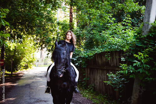 Emotional portrait of a horsewoman rider woman, astride, in love with horses, bl Poster
