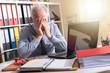 Tired businessman with headache, light effect