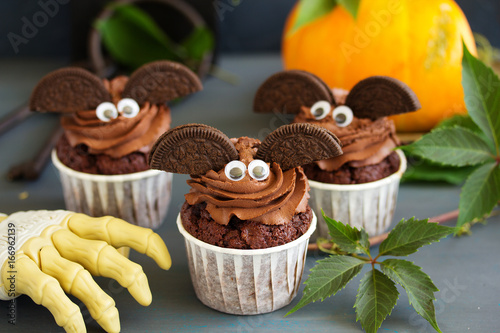 Sticker Chocolate muffins, with a chocolate cream in the form of bat on Halloween.