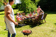man cooking meat on barbecue grill at summer party - 166999586