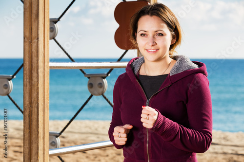 Young woman running in beach