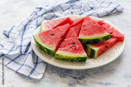 Slices of juicy watermelon on a ceramic dish.