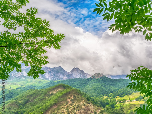Nature background with mountain, blue sky and white clouds