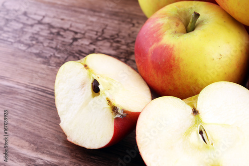 Ripe red apples on wooden background summer concept - 167039928