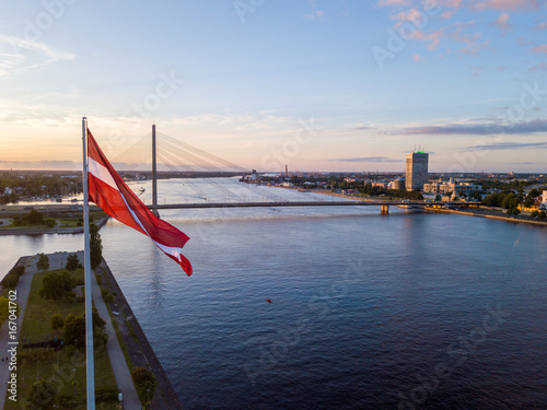 Staande foto India Beautiful aerial sunset view over AB dam in Riga Latvia with a huge Latvian flag