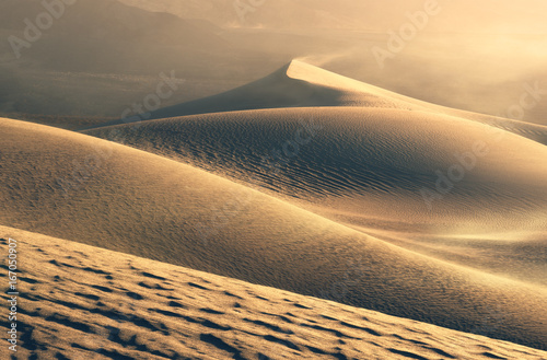 Strong gusts of wind blow among the sand dunes of Death Valley.