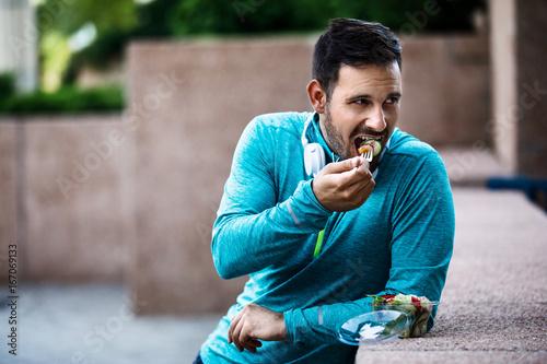 Poster Man is eating vegetable salad