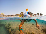 Snorkel swim in shallow water with coral fish, Red Sea, Egypt - 167069507
