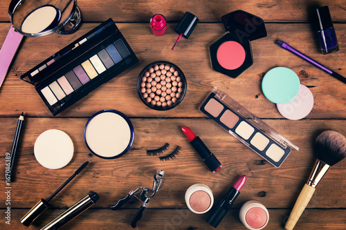 makeup cosmetics on wooden background. top view