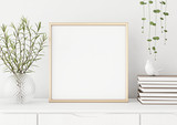 Interior poster mock up with square metal frame and plants in vase on white wall background. 3D rendering. - 167111167
