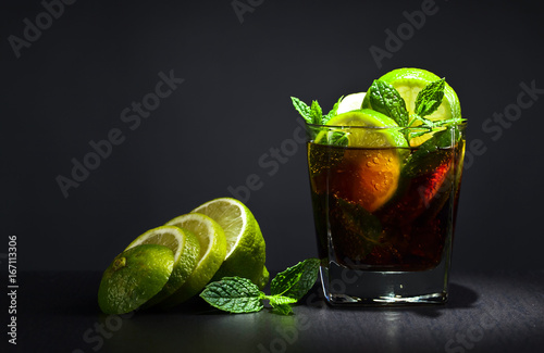 Cocktail with lime , ice  and peppermint . Poster