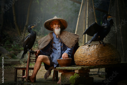 Fotobehang Guilin Cormorant fisherman and teal after a fishing