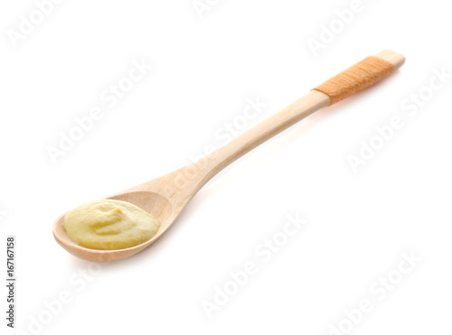 Aluminium Kruiden Spoon with delicious mustard sauce on white background