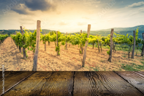 Vineyards and wooden empty boards for bottle display