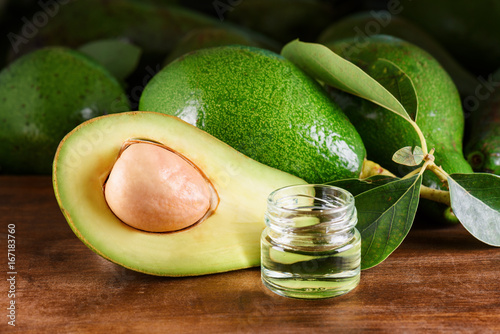 Fresh green avocados and natural avocado oil. Handmade cosmetic