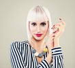 Fashion Portrait of Cute Woman with Blonde Hair and Manicure Hands