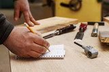 Carpenter calculates dimensions. Carpentry workshop. - 167207989