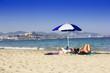Ibiza sandy beach young girl under a umbrella