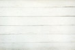 A background of weathered white painted wood