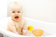 Quadro happy excited baby taking a bath