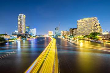 cityscape at night chao phraya river of bangkok city landscape Thailand , long exposure light