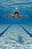 Female smiling underwater - 167215117