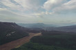 View from the mountain. Back background of nature. Valley in the mountains. Evening landscape. Partly cloudy. Fields and forests from a bird's eye view. Summer. Nature. Crimea. On the Sunset.