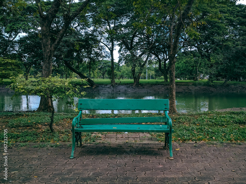 Green bench in Lumphini Park, Bangkok