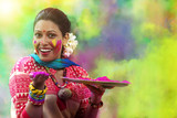 Portrait of a teenage Indian girl celebrating Holi festival with traditional dresses and ornaments