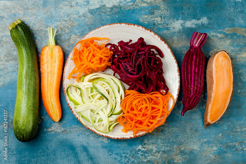 Zucchini, carrot, sweet potato and beetroot noodles on a plate Poster