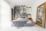 Bedroom with large wooden mirror - 167248703