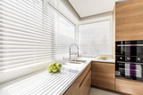 Kitchen with white window blinds - 167248744