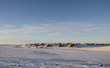 Arctic community of Cambridge Bay in the fall with snow on the ground and blue skies