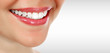 Quadro Pretty woman smiling against a grey background with copyspace. Closeup shot