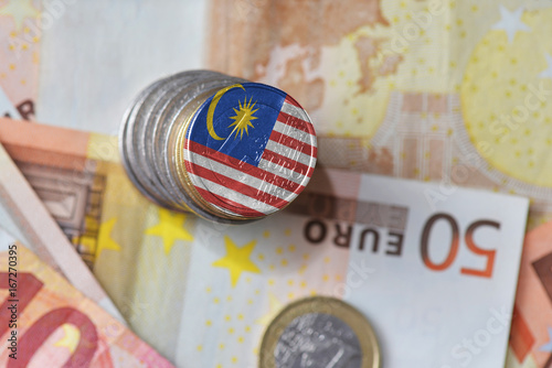 Spoed canvasdoek 2cm dik Kuala Lumpur euro coin with national flag of malaysia on the euro money banknotes background.
