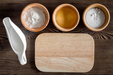 Put the dough. Ingredients on dark wooden table background top view mockup