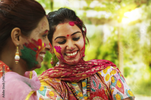 Foto Murales Two teenage Indian girls celebrating Holi festival with traditional dresses and ornaments