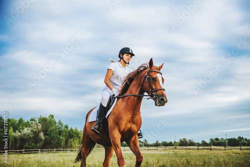 Girl jockey riding a horse Poster