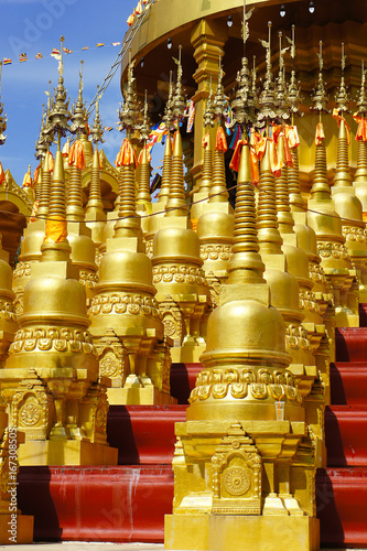 Golden pagoda at Wat Pa Sawang Bun in Saraburi Province, Thailand. There are 500 small pagodas decorated around big pagoda.