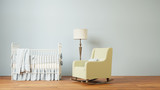 Nursery room with crib and chair