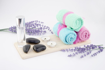Spa and aromatherapy concept on white background. Zen stones, accessories used in aromatherapy.  © HEMINXYLAN