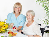 Carer spoon-feeds a elderly person  - 167361505