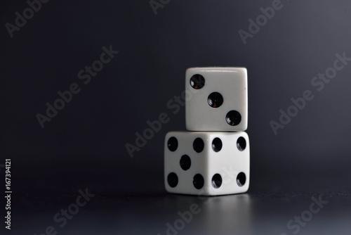 Two white dice ob black плакат