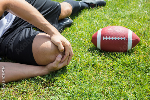 Sticker Male Rugby Player Suffering From Knee Injury