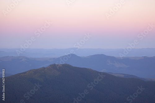 Foto op Canvas Lichtroze Nature in Carpathian Mountains at sunset.