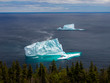 Two icebergs near a shore seen from high angle in St. John's, Newfoundland, Canada