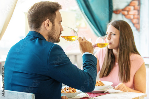 Happy Couple in a Restaurant - 167443129