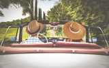 road in tuscany and two lovers in retro car