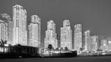 Black and white picture of Dubai at night, UAE.