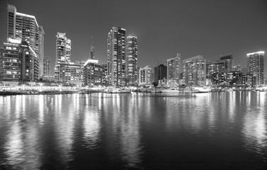 Black and white picture of Dubai marina at night, UAE.